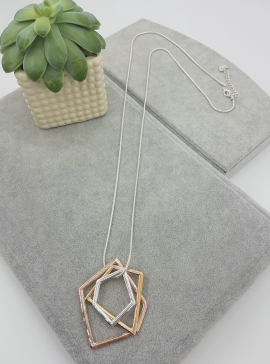 long pendant with gold silver and rose gold angular shapes